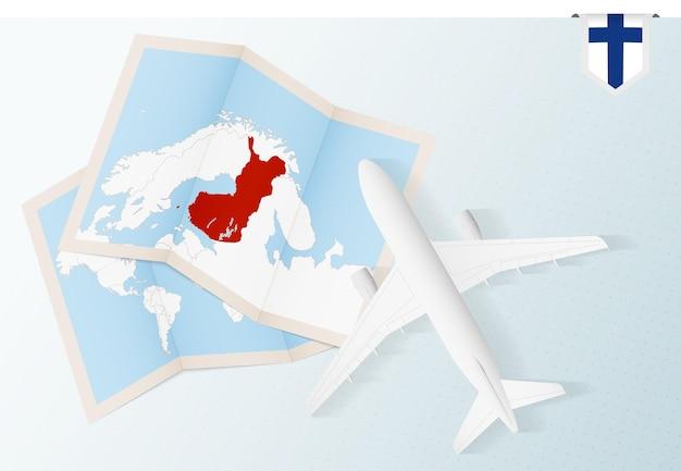 Viajar para a finlândia, vista superior do avião com o mapa e a bandeira da finlândia.