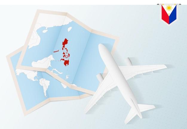 Viajar para as filipinas, avião com vista superior e mapa e bandeira das filipinas.
