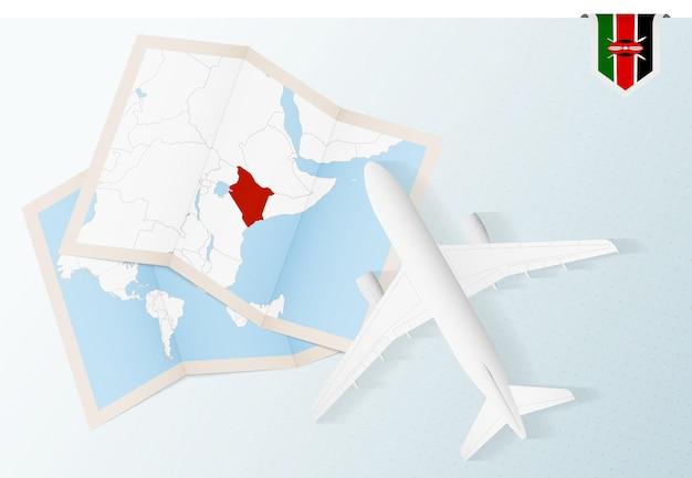 Viajar para o quênia, vista superior do avião com mapa e bandeira do quênia.