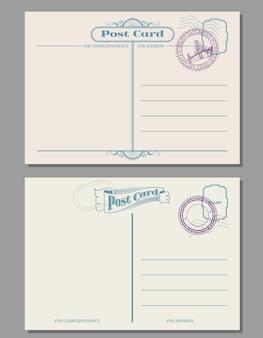 Viaje vintage cartão postal em branco com carimbos de borracha.