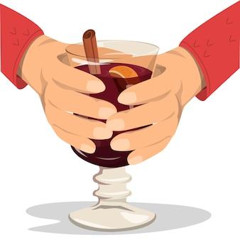 Vinho quente, mãos segurando um copo com uma bebida deliciosa