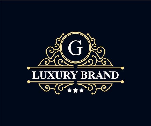 Vintage retrô luxo vitoriano emblema caligráfico logotipo heráldico com coroa e moldura ornamental