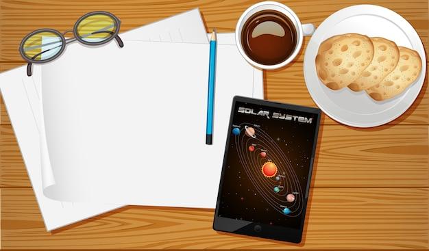 Vista aérea da mesa com tela do celular