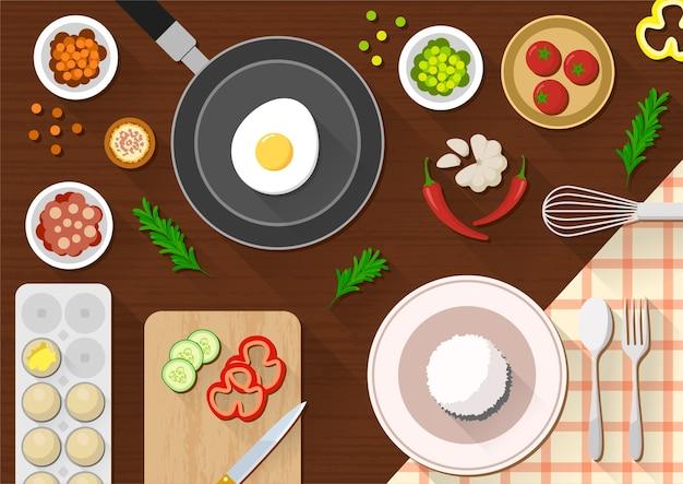 Vista de cima da mesa da cozinha com vários ingredientes para cozinhar
