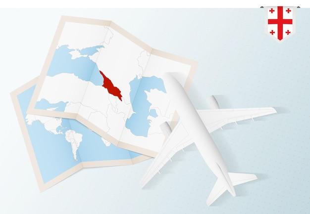 Vista de cima do avião com mapa e bandeira da geórgia