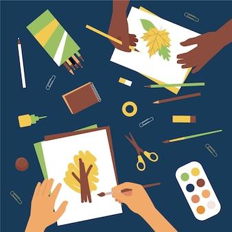 Vista de cima pessoas desenhando elementos de outono