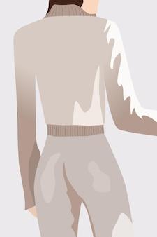 Vista de trás de uma mulher morena vestida com calças e suéter branco.