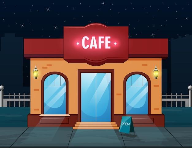 Vista frontal de um edifício de café à noite