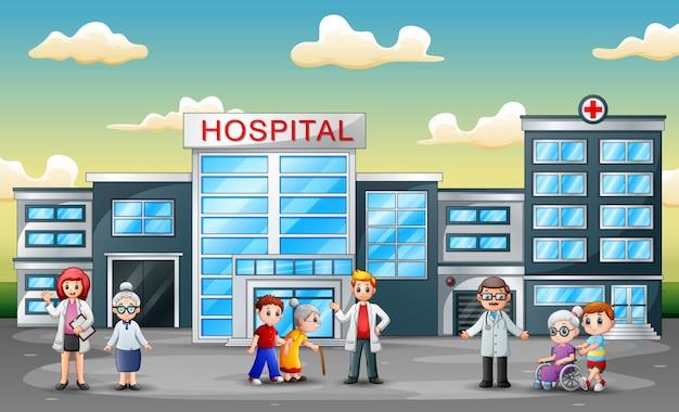 Vista frontal do hospital com funcionários e ambulância