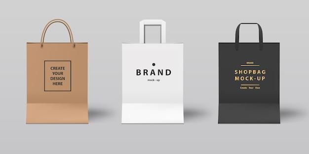 Vista frontal do mock-up realista saco de compras conjunto branco, preto e papel, para a marca.