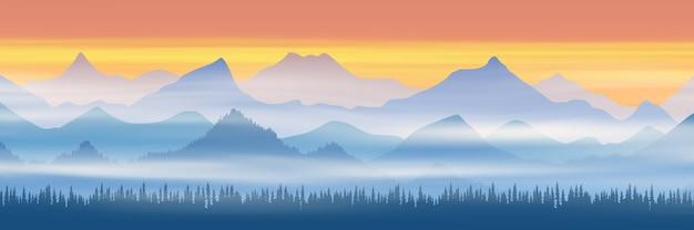 Vista panorâmica de cadeias de montanhas em meio à névoa matinal