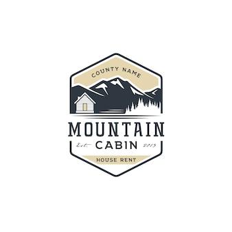Vista para a montanha com cabine para logotipo de aluguel de casa de aldeia