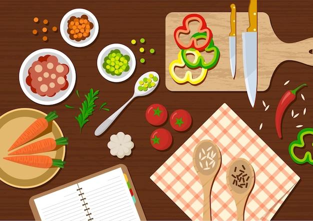 Vista superior da mesa da cozinha com vegetais e utensílios de cozinha