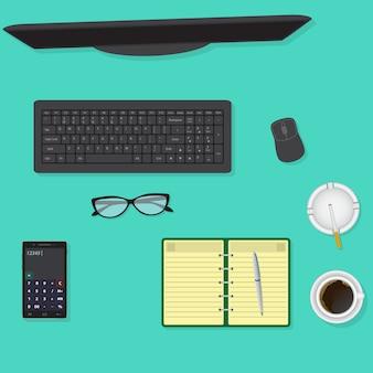 Vista superior da mesa de escritório, incluindo monitor, teclado e mouse, óculos, xícara de café.
