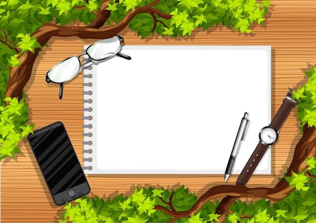 Vista superior da mesa de madeira com objetos de escritório e elemento de folhas