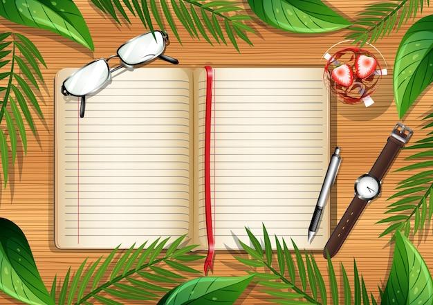 Vista superior da mesa de madeira com página em branco do livro e objetos de escritório e elemento de folhas