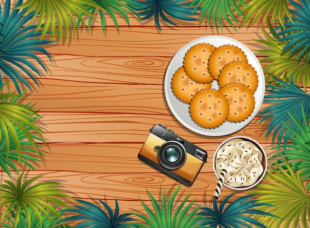 Vista superior da mesa de madeira com sobremesa e café gelado e câmera e elemento de folhas