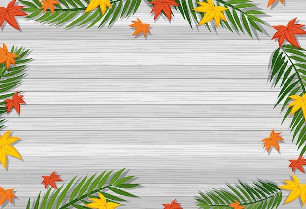 Vista superior da mesa de madeira em branco com folhas em elementos de estações diferentes