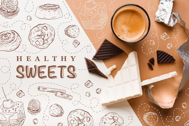 Vista superior de barras de chocolate com uma xícara de café