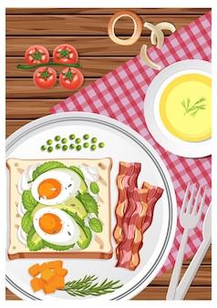 Vista superior do café da manhã em um prato com uma xícara de chá na mesa