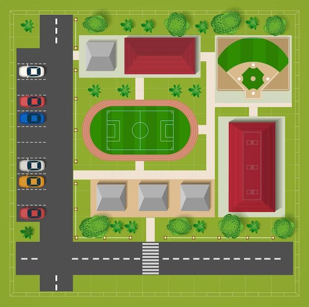 Vista superior do estádio de futebol do estacionamento com carros e árvores.