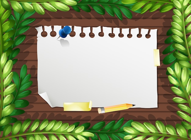 Vista superior do papel em branco na mesa com elementos de folhas
