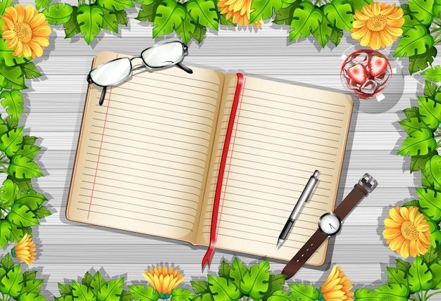Vista superior do papel em branco na mesa com folhas e elementos de girassol