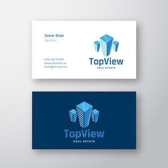 Vista superior imobiliária abstrato moderno vetor logotipo e cartão de visita modelo arranha-céu silhuetas p ...