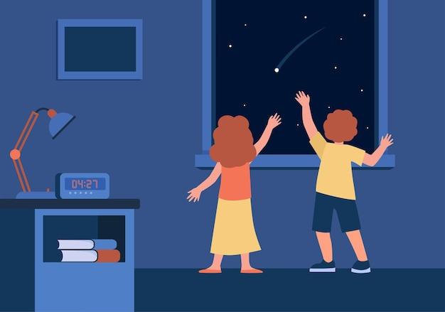 Vista traseira de crianças observando o céu noturno com uma estrela cadente