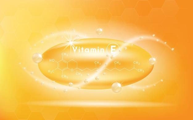 Vitamina e e estrutura. cápsula do medicamento, substância dourada.