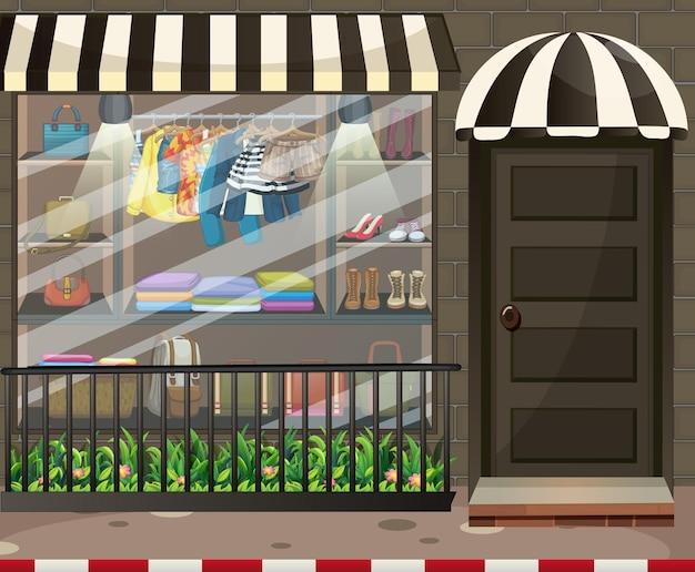 Vitrine da frente da loja de roupas com roupas e acessórios