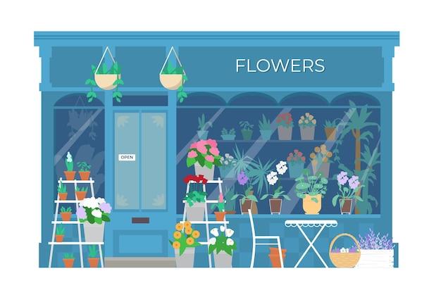 Vitrine do prédio da floricultura com plantas e flores em baldes e potes