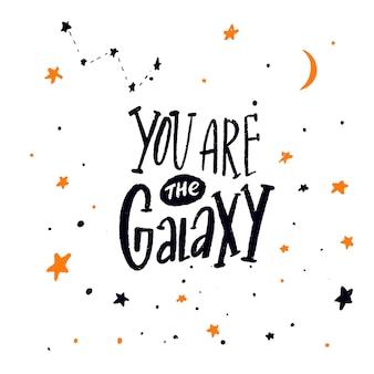 Você é a galáxia citação inspiradora de cartão romântico com letras de mão nas estrelas Vetor Premium