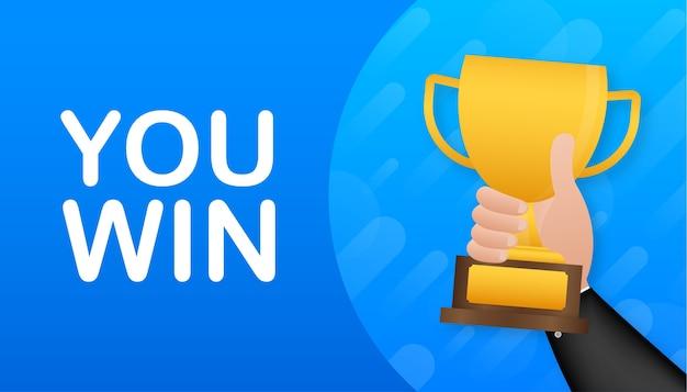 Você ganha. mão está segurando uma taça de prêmio de ouro. um conceito de vitória, liderança e competição