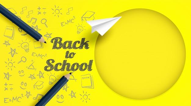Volta para escola design com lápis e desenho em fundo de papel amarelo