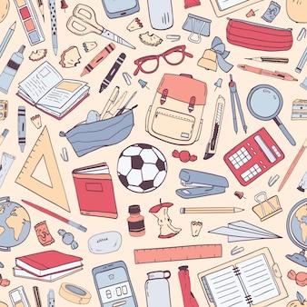 Volta para escola padrão sem emenda com material de educação ou artigos de papelaria na luz de fundo.