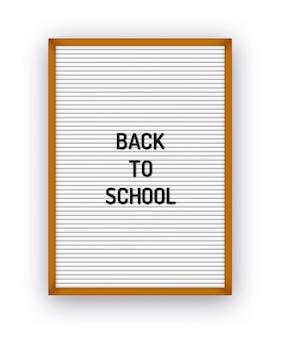 Voltar ao texto escolar em papel timbrado com letras de plástico.