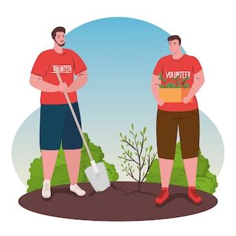Voluntários homens com plantação de pá