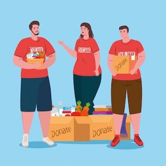 Voluntários homens e mulheres com caixas de doações