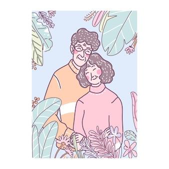 Vovô e avó amam em pé no jardim de flores.