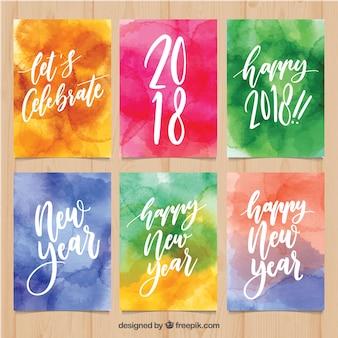 Watercolor cartões de ano novo em cores brilhantes