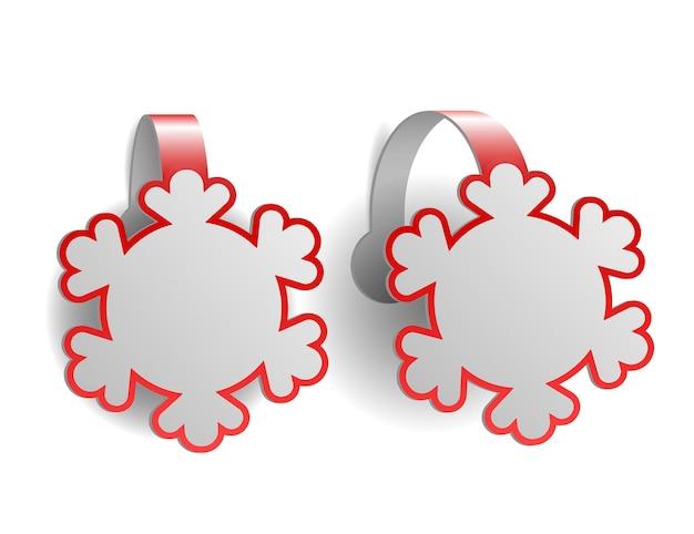 Wobblers de publicidade vermelhos em forma de flocos de neve isolados no branco
