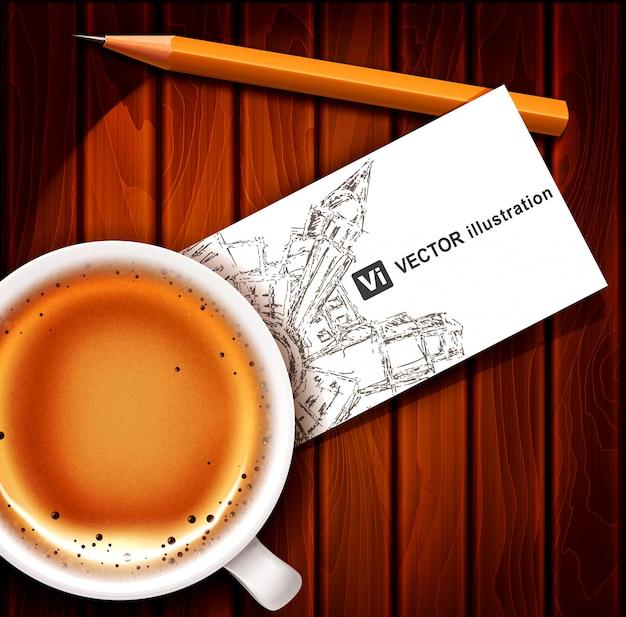 Xícara de café com cartão e lápis sobre uma mesa de madeira.