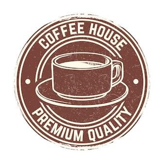 Xícara de café com distintivo de efeito grunge