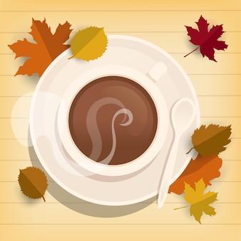 Xícara de café na mesa de madeira com folhas de outono, vista de cima