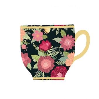 Xícara de chá bonita com flor e folhas no fundo preto.