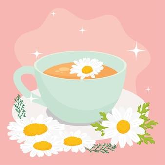 Xícara de chá de camomila e flores