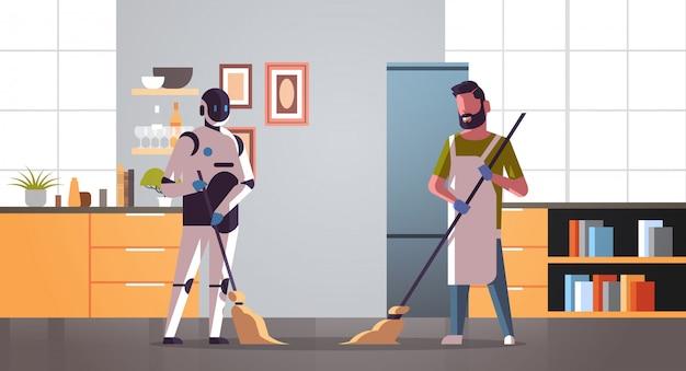 Zelador robótico com varredor de homem e robô de limpeza vs humano em pé juntos conceito de tecnologia de inteligência artificial cozinha moderno interior comprimento total horizontal