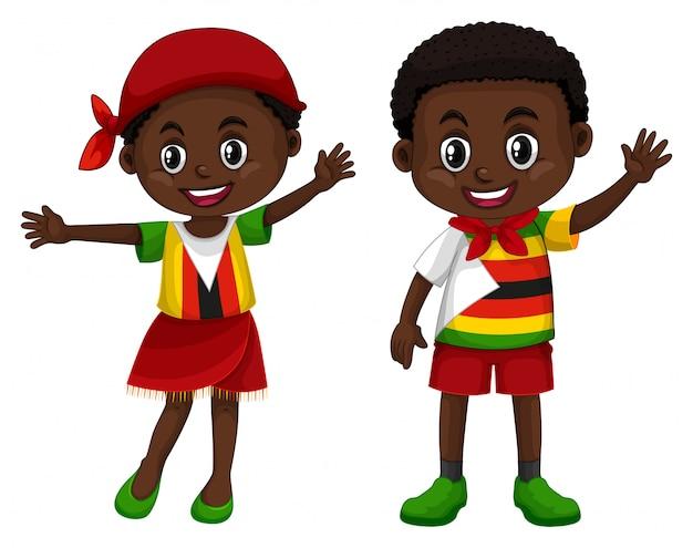 Zimbabué menino e menina em traje de cor de bandeira