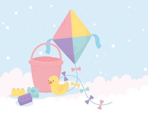 Zona de crianças, brinquedos pipa balde pato e blocos de fundo